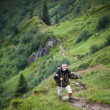 Active senior hiking in high mountains (Swiss Alps) — Stock Photo #9389028