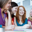 Four female college students working on their homework — Stockfoto #9389045