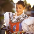 Stock Photo: Young womin richly decorated ceremonial folk dress