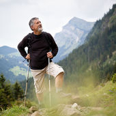 Active senior hiking in high mountains (Swiss Alps) — Stock Photo