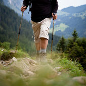 Active senior hiking in high mountains (Swiss Alps) — Stok fotoğraf