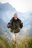 Active senior hiking in mountains (Swiss Alps) — Stock Photo