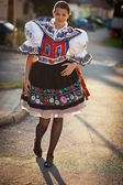 Young woman in a richly decorated ceremonial folk dress — Stock Photo