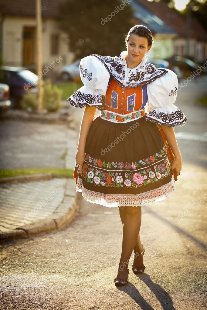 Keeping tradition alive: young woman in a richly decorated ceremonial folk dress/regional costume (Kyjov folk costume, Southern Moravia, Czech Republic) — Stock Photo #9389053