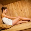 Young woman relaxing in a sauna — Stock Photo #9557106
