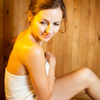 Young woman relaxing in a sauna — Stock Photo #9557114