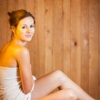Young woman relaxing in a sauna — Stock Photo #9557117