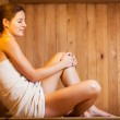 Young woman relaxing in a sauna — Stock Photo #9557119