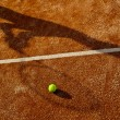 Stock Photo: Shadow of tennis player in action on tennis court