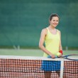 Pretty, young female tennis player on the tennis court — Stock Photo #9557127