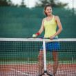 Pretty, young female tennis player on the tennis court — Stock Photo #9557129
