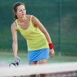 Pretty, young female tennis player on the tennis court — Stock Photo #9557131