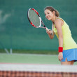 Pretty, young female tennis player on the tennis court — Stock Photo #9557132
