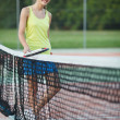 Pretty, young female tennis player on the tennis court — Stock Photo #9557135