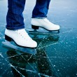 Young woman ice skating outdoors on a pond — Stock Photo #9557136