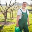 Portrait of a senior gardener in his garden/orchard — Stock Photo #9557199