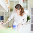 Young woman doing housework, cleaning the kitchen — Stock Photo #9557256