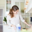 Young woman doing housework, cleaning the kitchen — Stock Photo #9557259