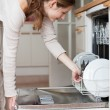 Young woman using a dishwasher — Stock Photo #9557283