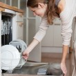 Young woman using a dishwasher — Stock Photo #9557285