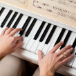 Playing Piano (shallow DOF; color toned image) — Stock Photo #9557311
