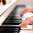 Playing Piano (shallow DOF; color toned image) — Stock Photo #9557323