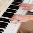 Stock Photo: Playing Piano (shallow DOF; color toned image)