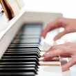 Playing Piano (shallow DOF; color toned image) — Stock Photo #9557330