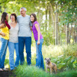 Family portrait - Family of four with a cute dog outdoors — Stok fotoğraf