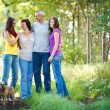 Family portrait - Family of four with a cute dog outdoors — Stock Photo #9557378