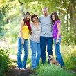 Family portrait - Family of four with a cute dog outdoors - 图库照片
