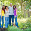 Family portrait - Family of four with a cute dog outdoors — Stock Photo #9557381