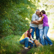 Family portrait - Family of four with a cute dog outdoors — Stock Photo #9557382