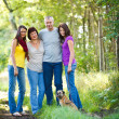 Family portrait - Family of four with a cute dog outdoors — Stock Photo #9557383