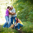 Family portrait - Family of four with a cute dog outdoors — Stock Photo #9557384