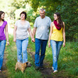 Family portrait - Family of four with a cute dog outdoors — Stock Photo