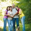 Family portrait - Family of four with a cute dog outdoors — Stock Photo #9557390