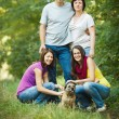 Family portrait - Family of four with a cute dog outdoors — Foto Stock