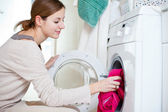 Housework: young woman doing laundry — Foto de Stock