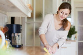 Young woman using a dishwasher — Stock Photo