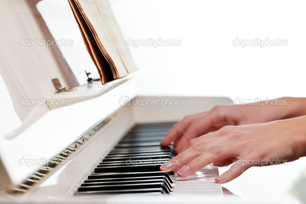 Playing Piano (shallow DOF; color toned image) — Stock Photo #9557312