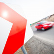 Stock Photo: Traffic concept: car driving fast through sharp turn