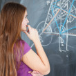 Pretty young college student writing on the chalkboard/blackboar — Stock Photo