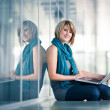 Pretty young female student with a laptop computer — Stock Photo #9790386