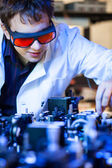 Scientist doing research in a quantum optics lab — Stock Photo