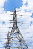 Transmission tower at blue sky — Stock Photo