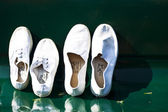 A pair of white shoes on chair — Stock Photo