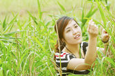 Asian woman in the grasses — Stock Photo