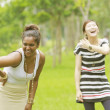 Two different races woman laughing, black and asian. — Stock Photo