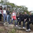 Asian hiking teams in mountains — Stock Photo #10689403